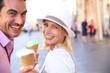 Cheerful couple in Rome eating ice cream cones