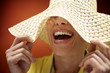 pretty woman with straw hat smiling and having fun