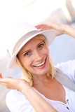 Portrait of beautiful blond woman with hat