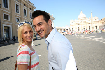 Tourits with map in front of Saint Peter's Basilica in Rome