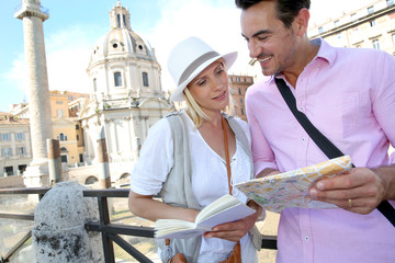 Coupe in Rome reading guide book by the Foro Traiano