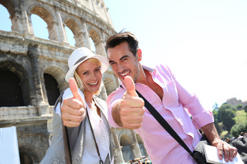 Couple showing thumbs up in front of the Coliseum