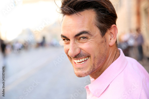 Closeup of handsome guy wearing pink shirt