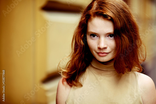 Portrait of a beautiful girl with freckles