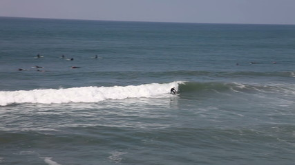 People surfing on the beach, Huntington Beach, CA
