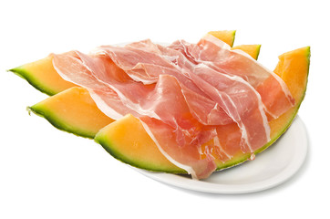 Ham and cantaloupe melon on the white