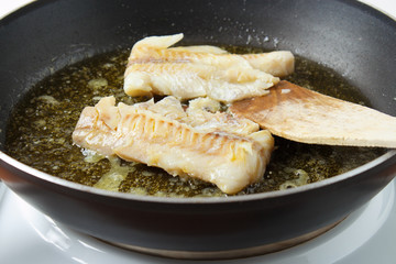 Cooking pollock fillets in frying pan