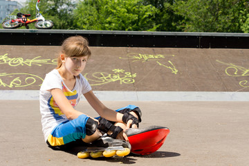 Young girl relaxing at the skate park