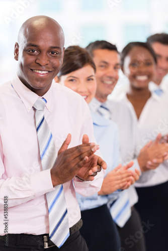 Happy business team applauding