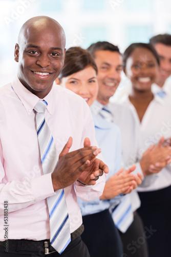 Happy business team applauding