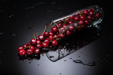 cherry falling from glass