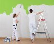 Young Couple Painting Wall