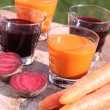 Carrot and beetroot juice and fresh vegetables