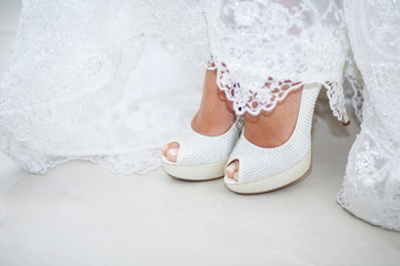 bride wearing wedding shoes close-up