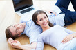 Couple on floor with laptop