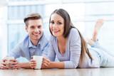 Couple on floor drinking coffee
