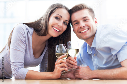 Couple on floor drinking wine
