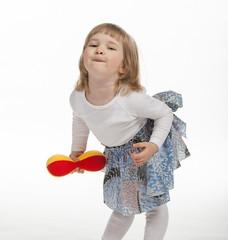 Dancing baby girl dressed in skirt