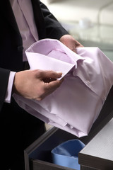 Choosing the right shirt. Close-up of businessman holding a shir