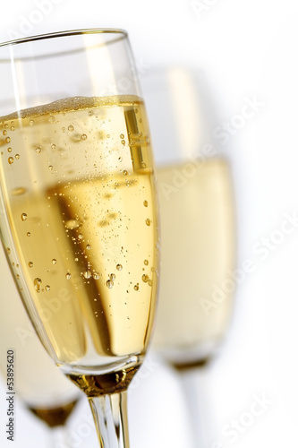 champagne flutes on white background