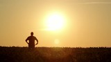 silhouette of a man walking at sunrise