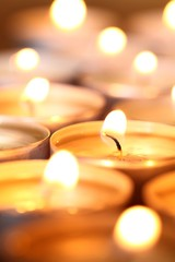 Candles close-up. Selective focus, shallow DOF.