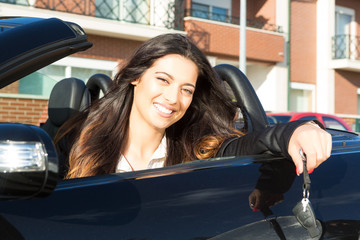 Business woman in sports car