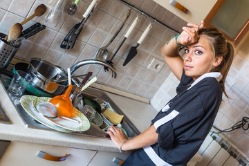 Housemaid Washing Dishes in the Kitchen