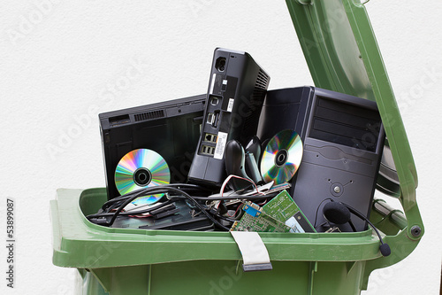 Discarded computer in litter bin