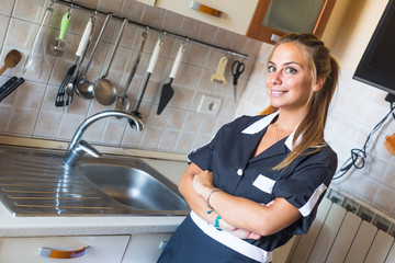 Happy Housemaid with Clean Kitchen