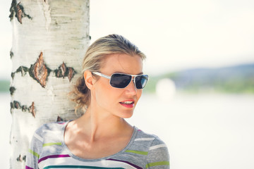 Beautiful Girl Wearing Sunglasses Is Looking Forward