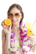 Hawaii woman in bikini wearing flower lei garland of pink orchid