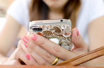 Woman's Hand Using Cell Phone