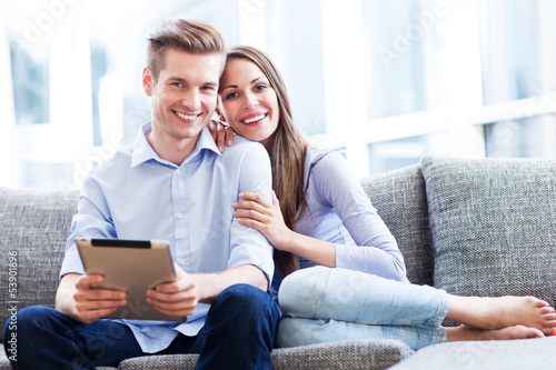 Couple on sofa with digital tablet