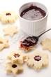 Baking shortbreat cookies with jam.