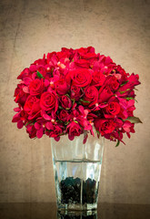 Bouquet of red rose in glass vase