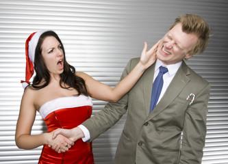 Sexy Female Santa Slaps Businessman