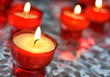 Closeup image of firing candles in red glasses