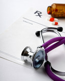Focus on Rx on prescription paperwork near stethoscope