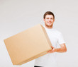 smiling man carrying carton box