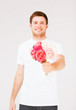young man holding bouquet of flowers