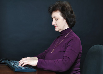 The aged woman in front of the monitor
