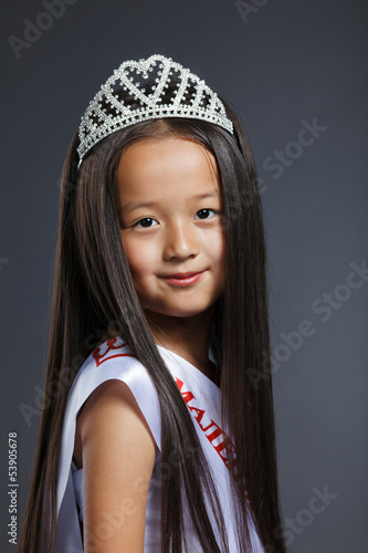 Portrait of cute little girl in precious tiara
