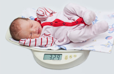 cute baby on the scales