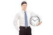 Smiling guy in suit holding a clock