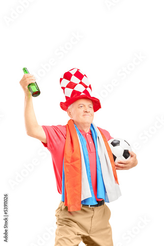 Mature male sport fan, with flag of Holland, holding a soccer ba