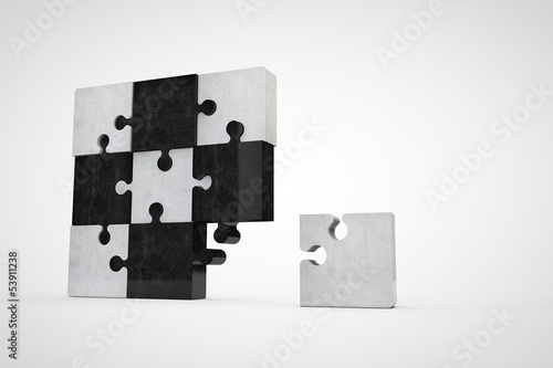 jigsaw puzzle made of bright and dark stone pieces