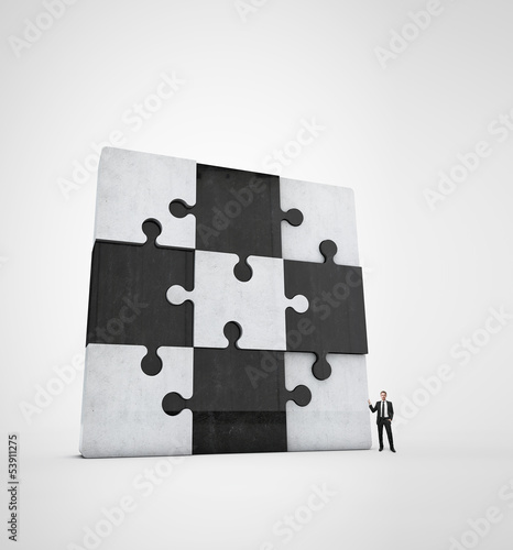 businessman near jigsaw puzzle