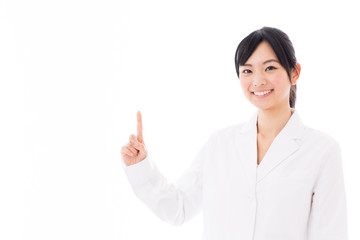 attractive asian doctor showing on white background