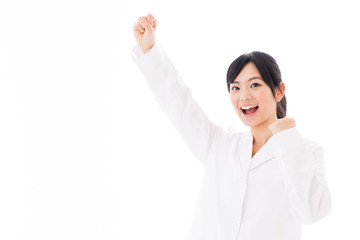 attractive asian doctor cheering on white background